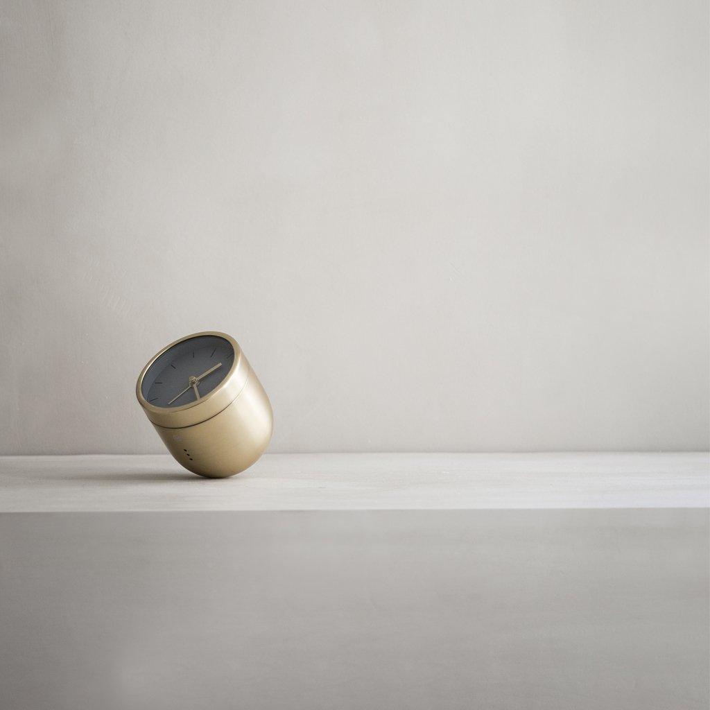 brass cylindrical alarm clock